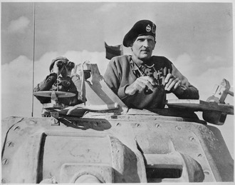 General_Bernard_L._Montgomery_watches_his_tanks_move_up._North_Africa,_November_1942._-_NARA_-_535939.tif