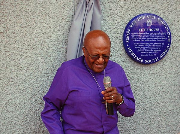 Archbishop_Desmond_Tutu_outside_Tuto_House,_Soweto