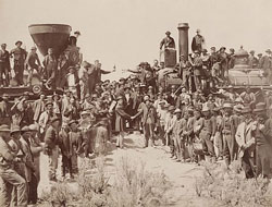 450px-East_and_West_Shaking_hands_at_the_laying_of_last_rail_Union_Pacific_Railroad_-_Restoration